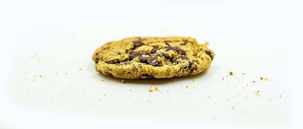 brown cookie on white surface