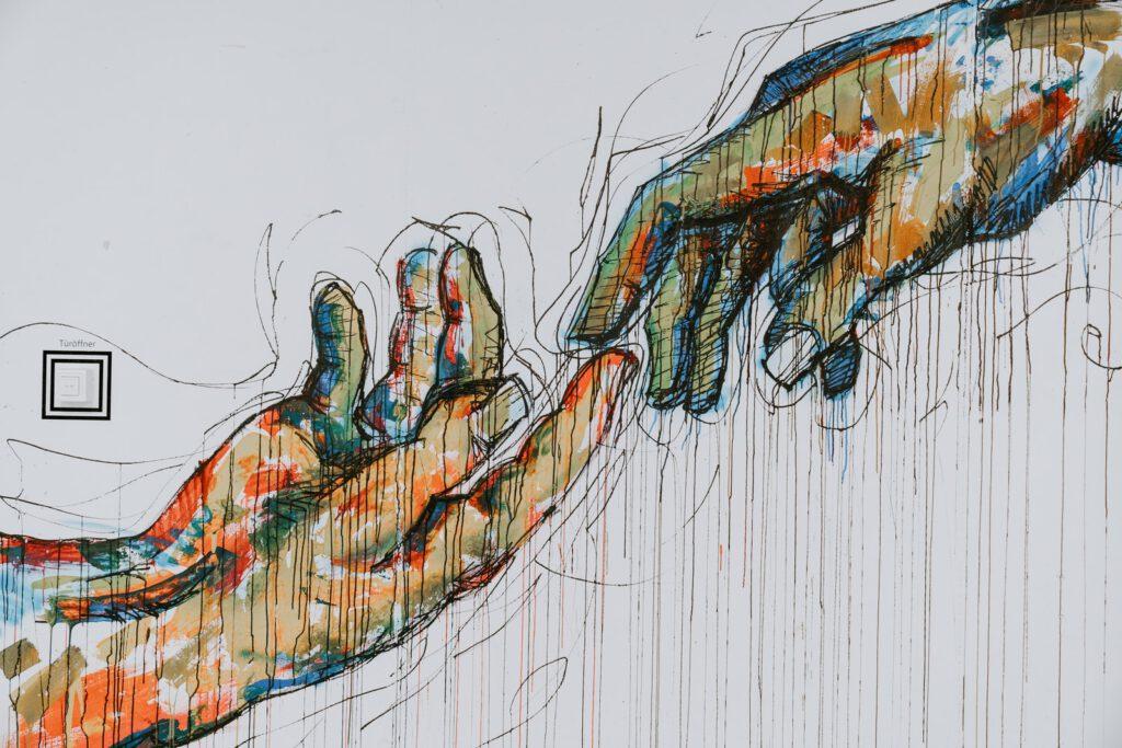 Kennenlern-Gespräch - zwei gezeichnete Hände, die sich berühren
